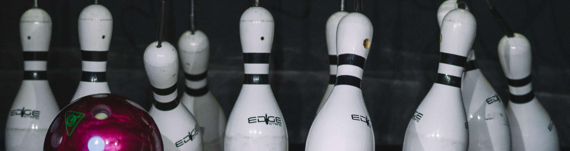 White Bowling Pins Being Knocked Over At Tenpin Bowling 11 (1)